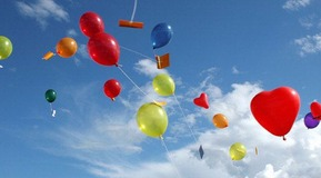Helium-filled balloons in various colours
